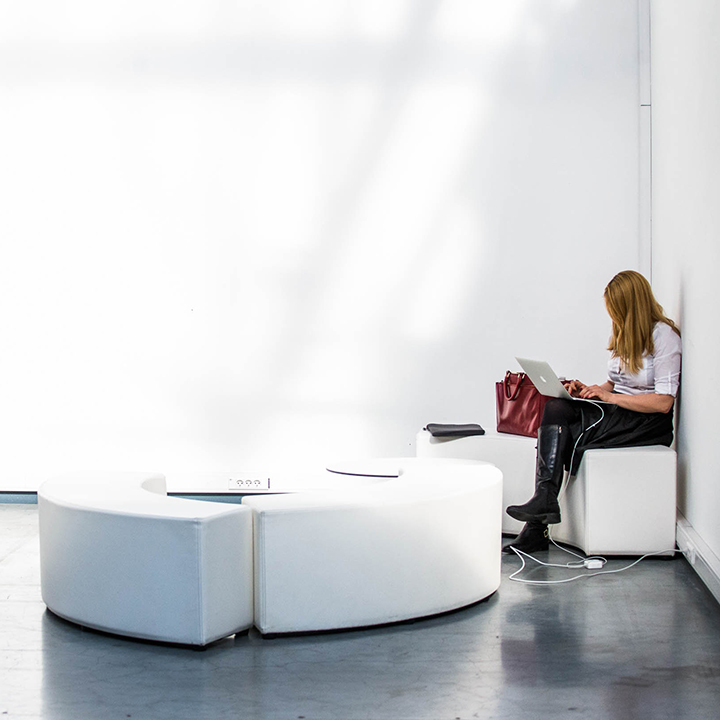 Woman in a corner with her laptop